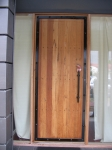 Timber door with steel banding