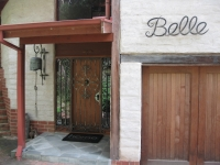 Bell, security door and house name.